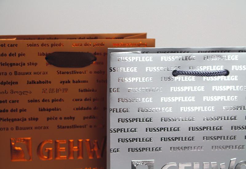 exklusive-Papiertaschen-Gewohl,-PP-Kordel-und-Band